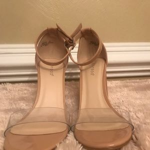 Nude Bamboo heels with clear strap.